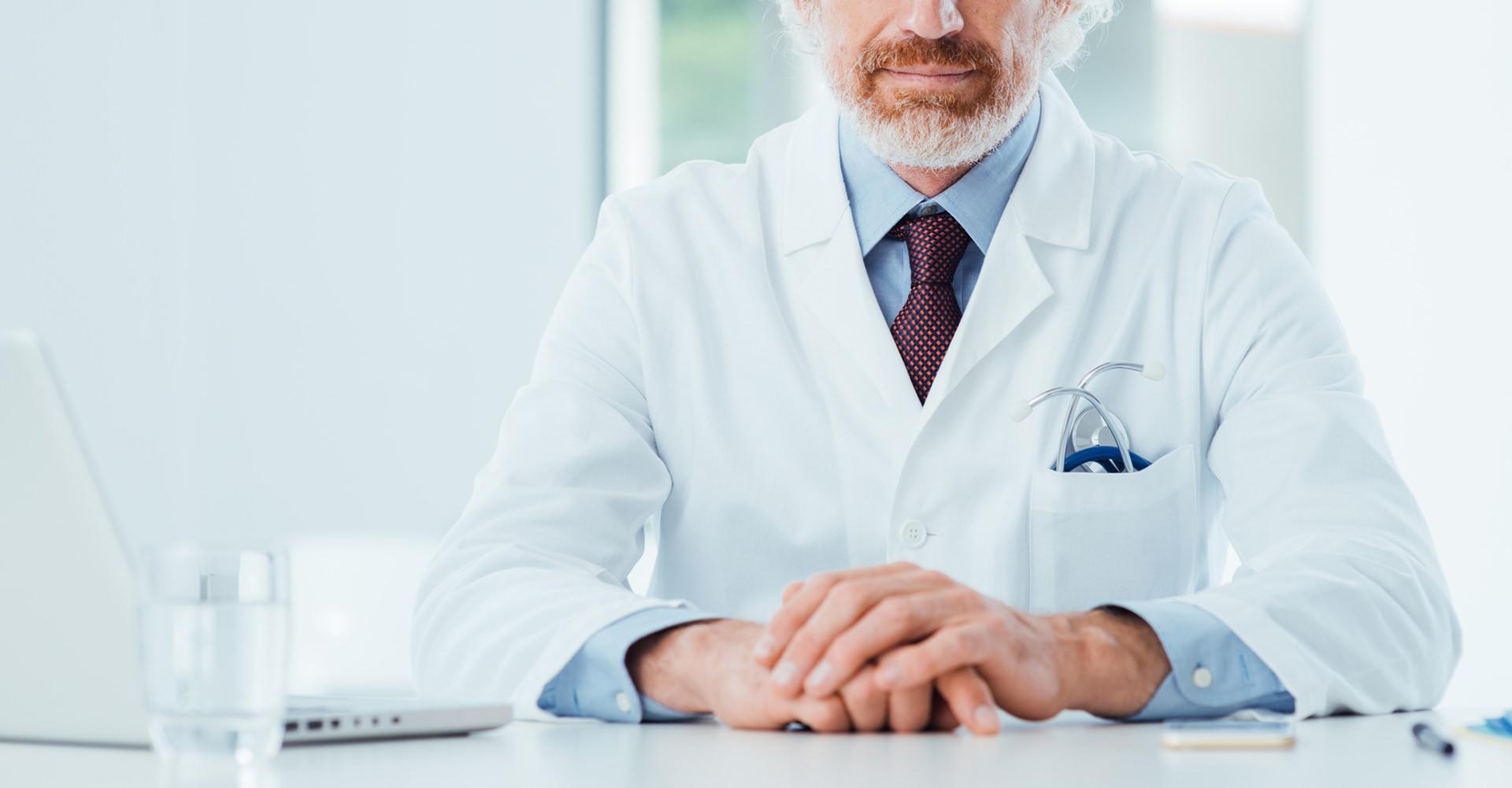 Caregiver doctor at desk