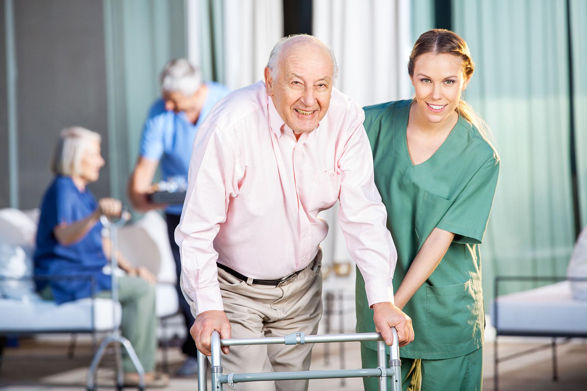 Caregiver Female Helping Senior Man