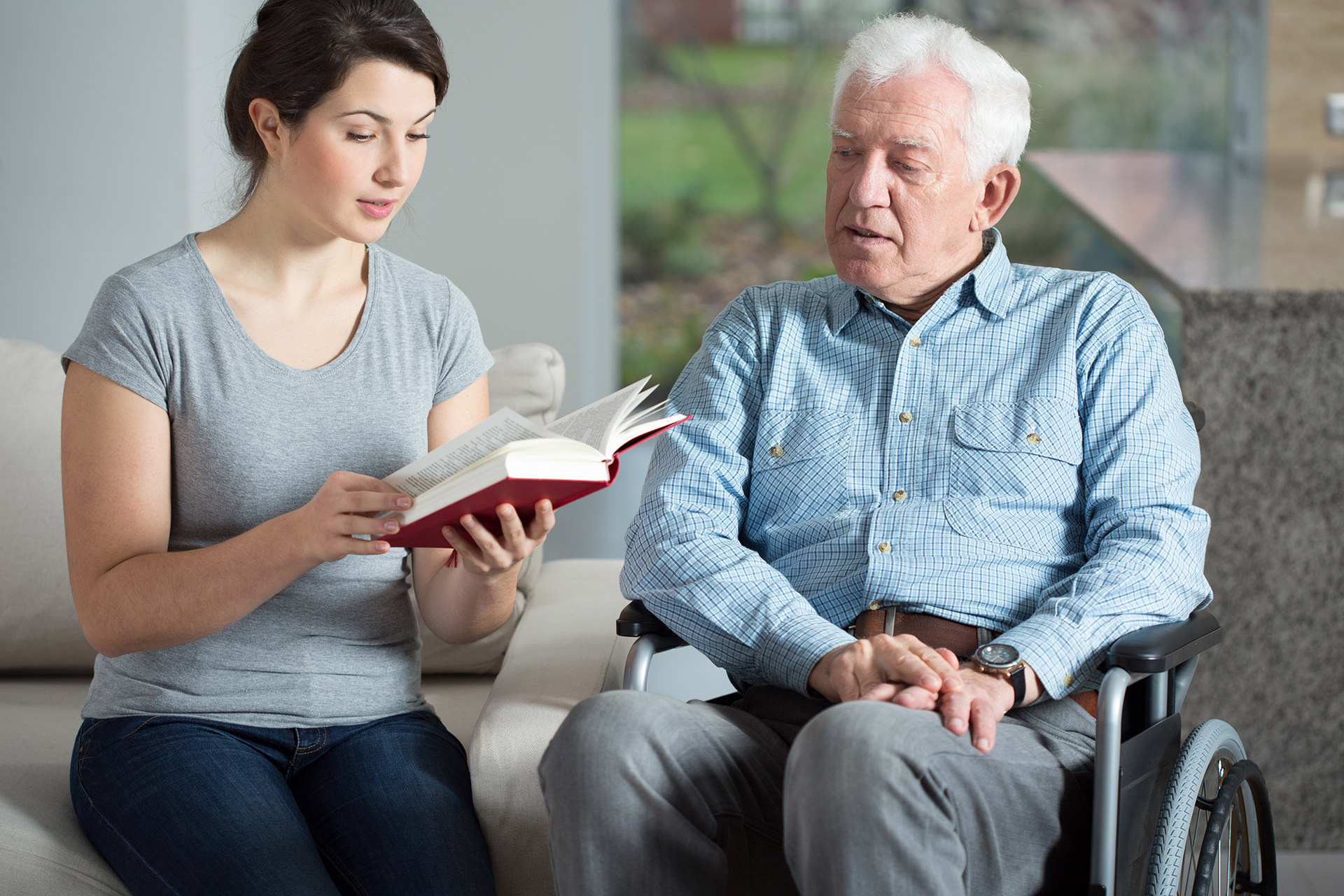 Caregiver lady reading book