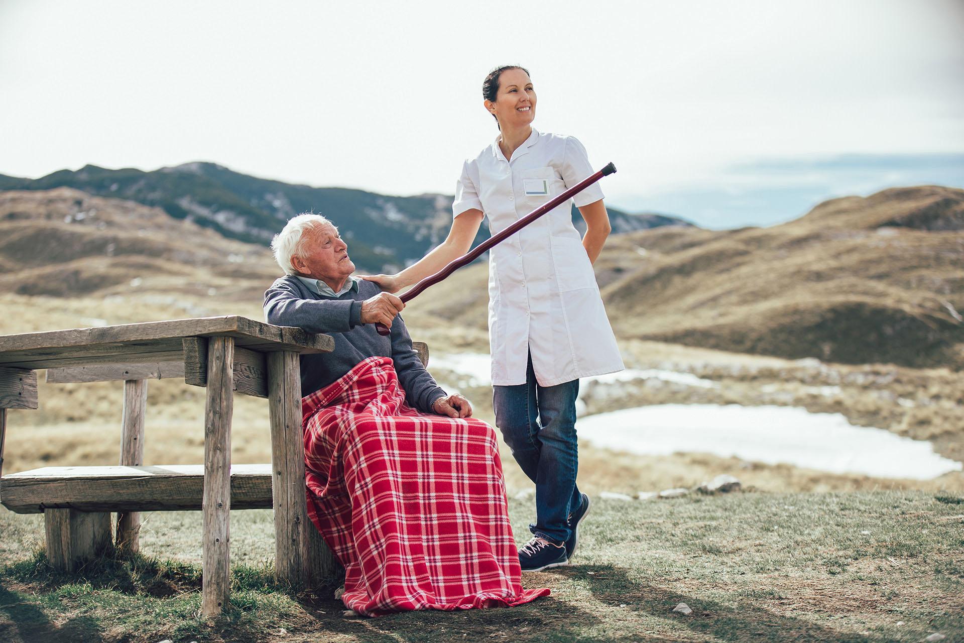 Caregiver nurse help to man