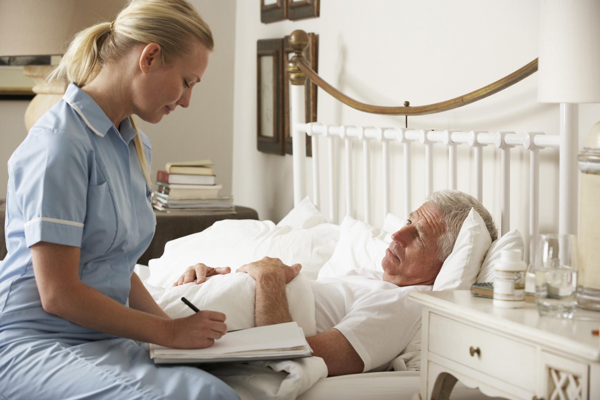 Caregiver nurse Visiting Senior Male