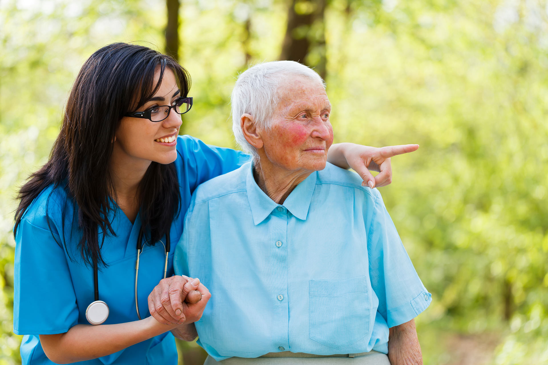 Caregiver nurse with old lady