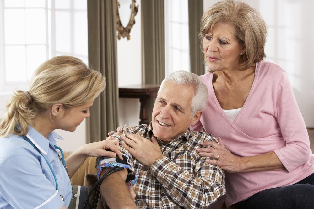 Caregiver nurse with senior couple