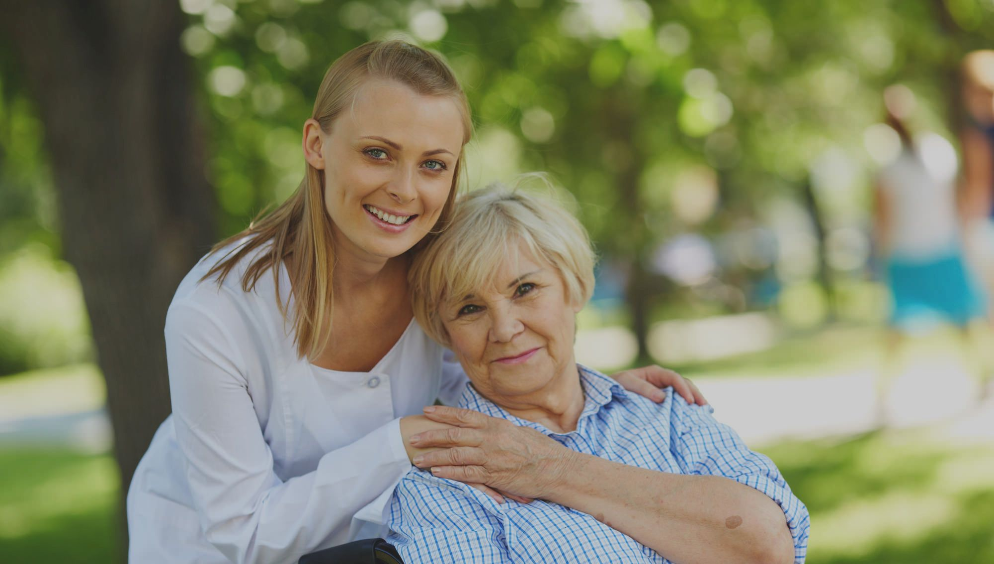 Caregiver Taking care of old patient