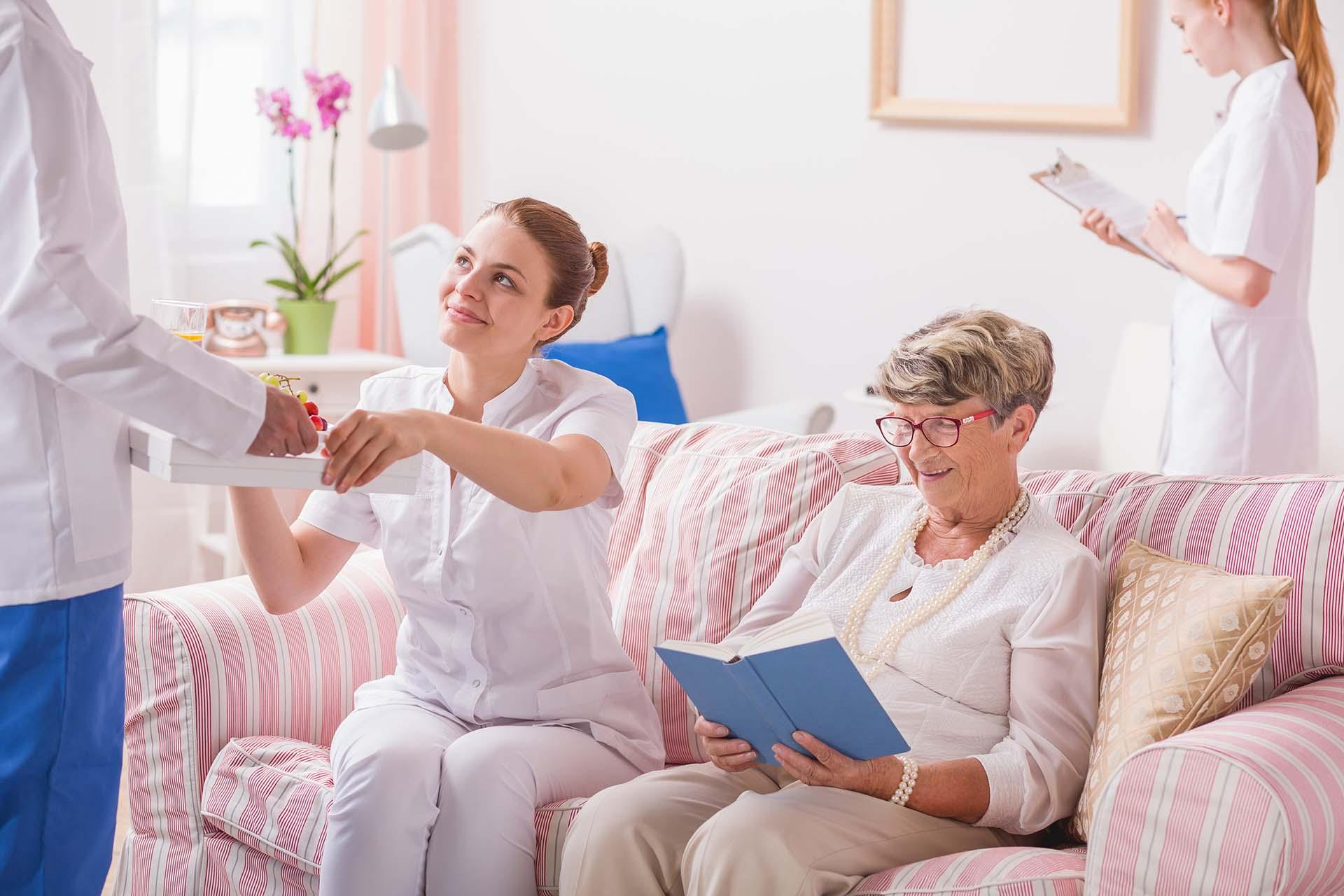 Caregivers nurses surrounded the elder woman