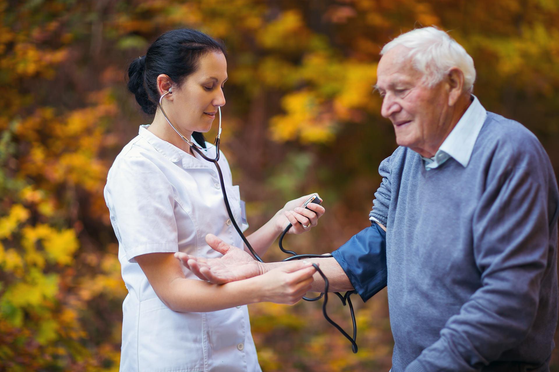 Caretaker check health to old man