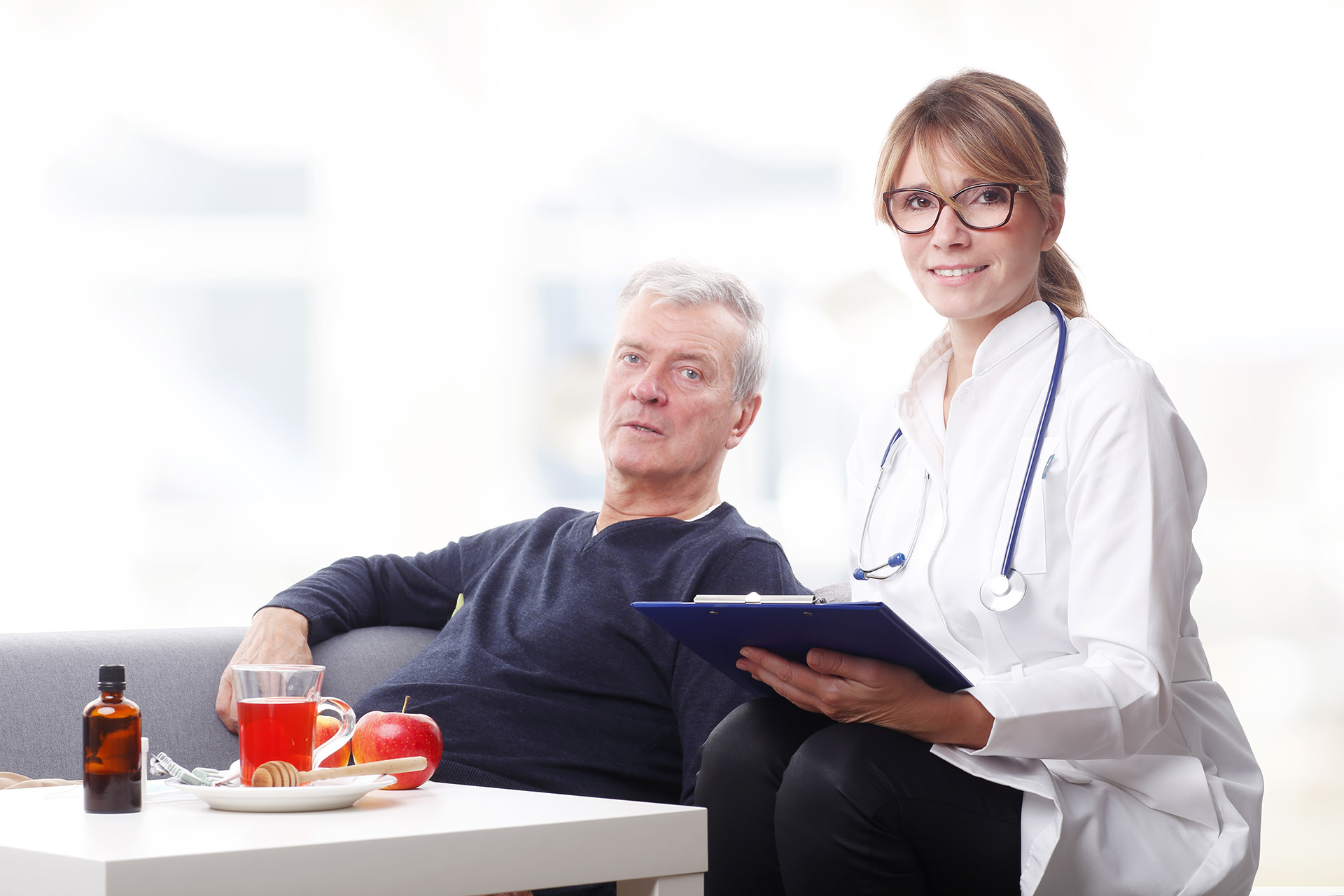 Female doctor and senior patient