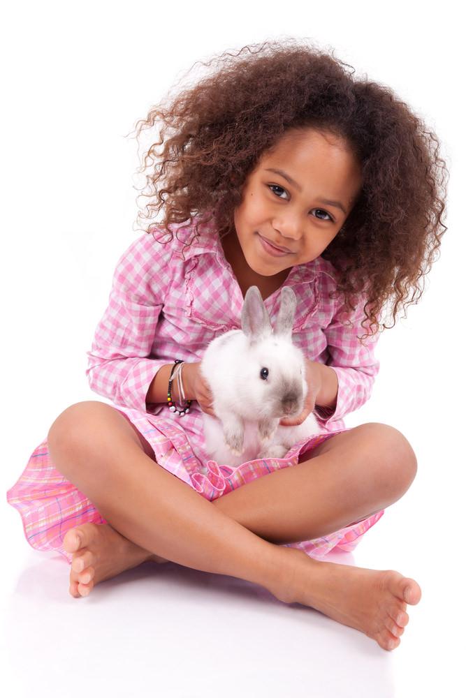 Girl holding a rabbit