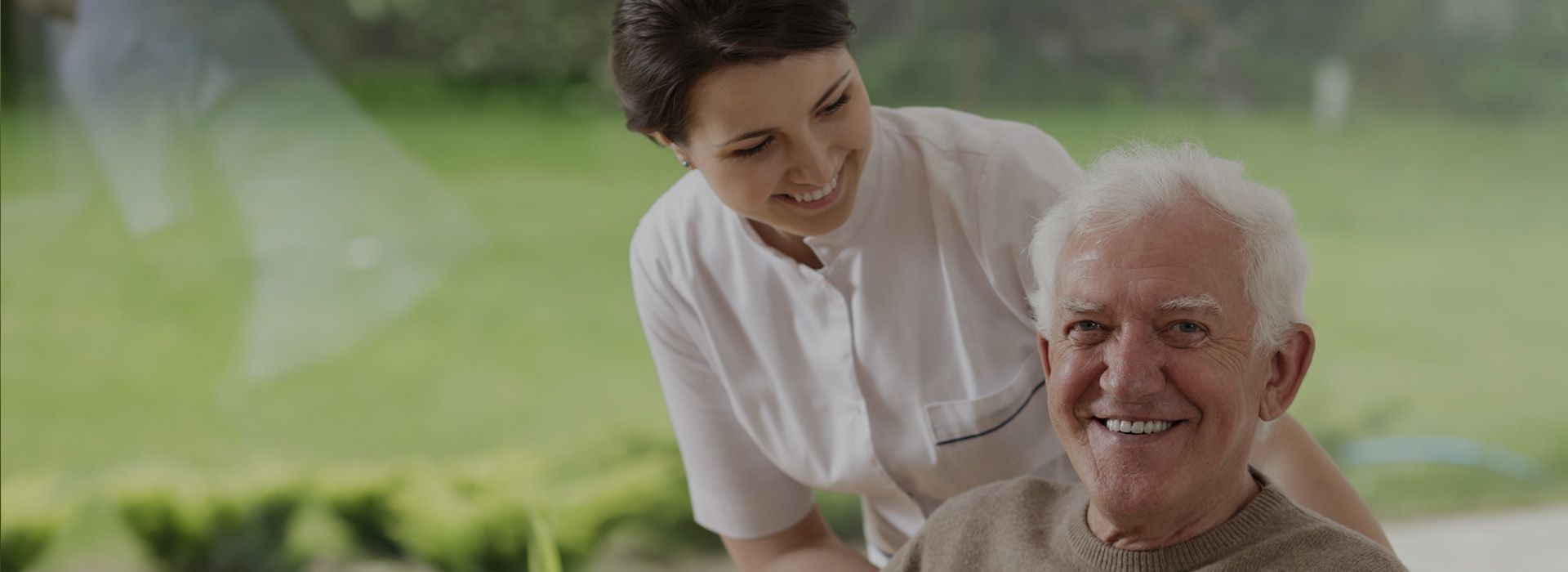 Loving-caregiver-with-an-elderly-man-at-his-home