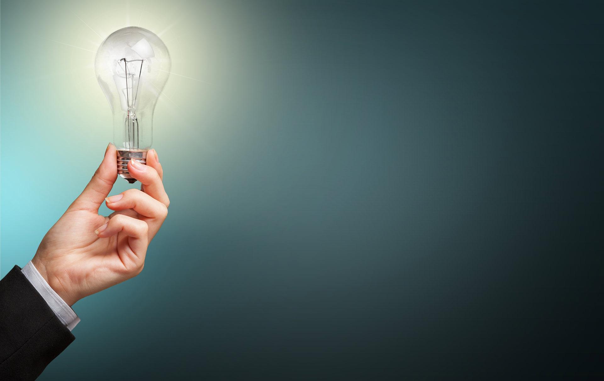 Man hold bulb on hand