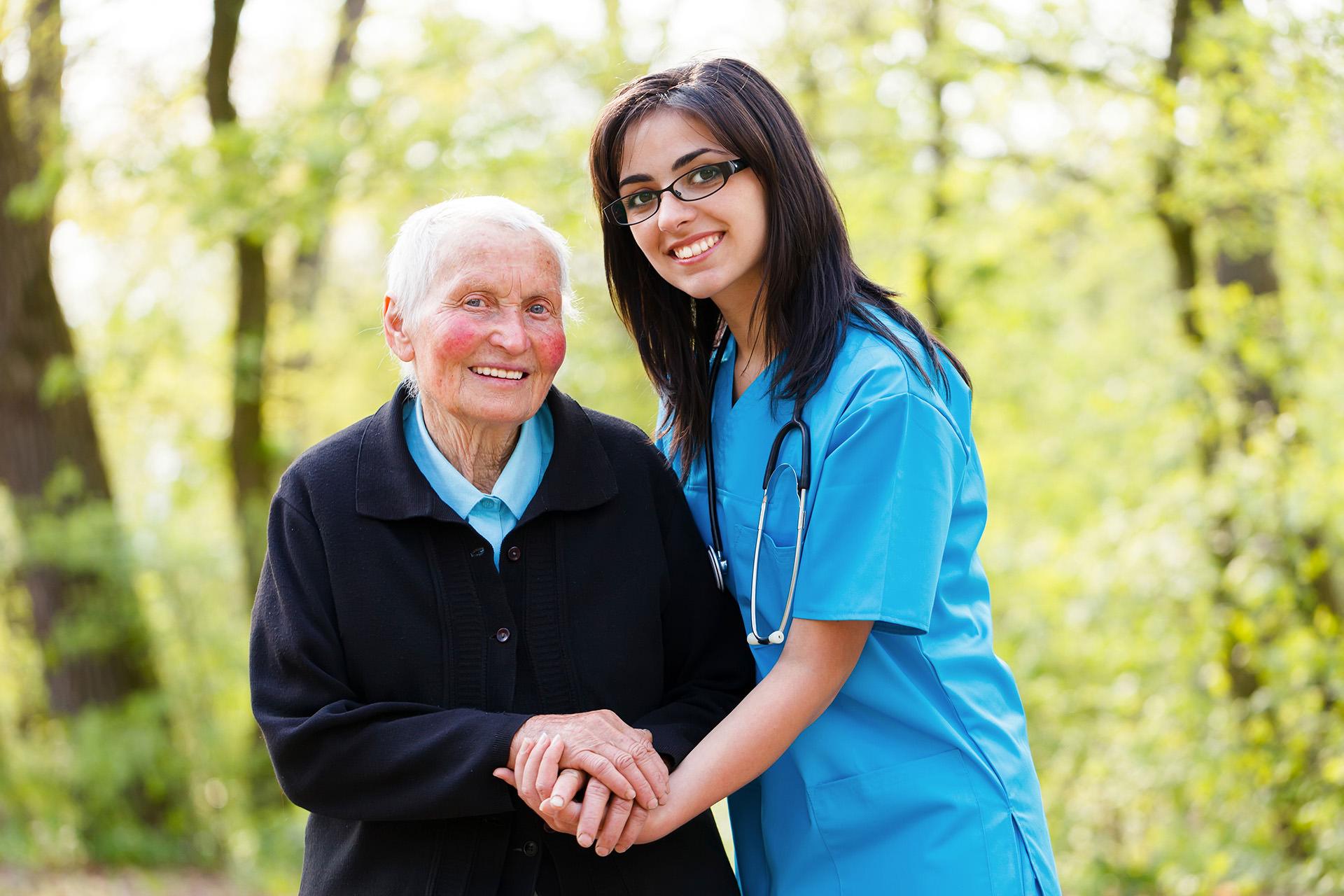 Senior Lady with Caretaker Nurse