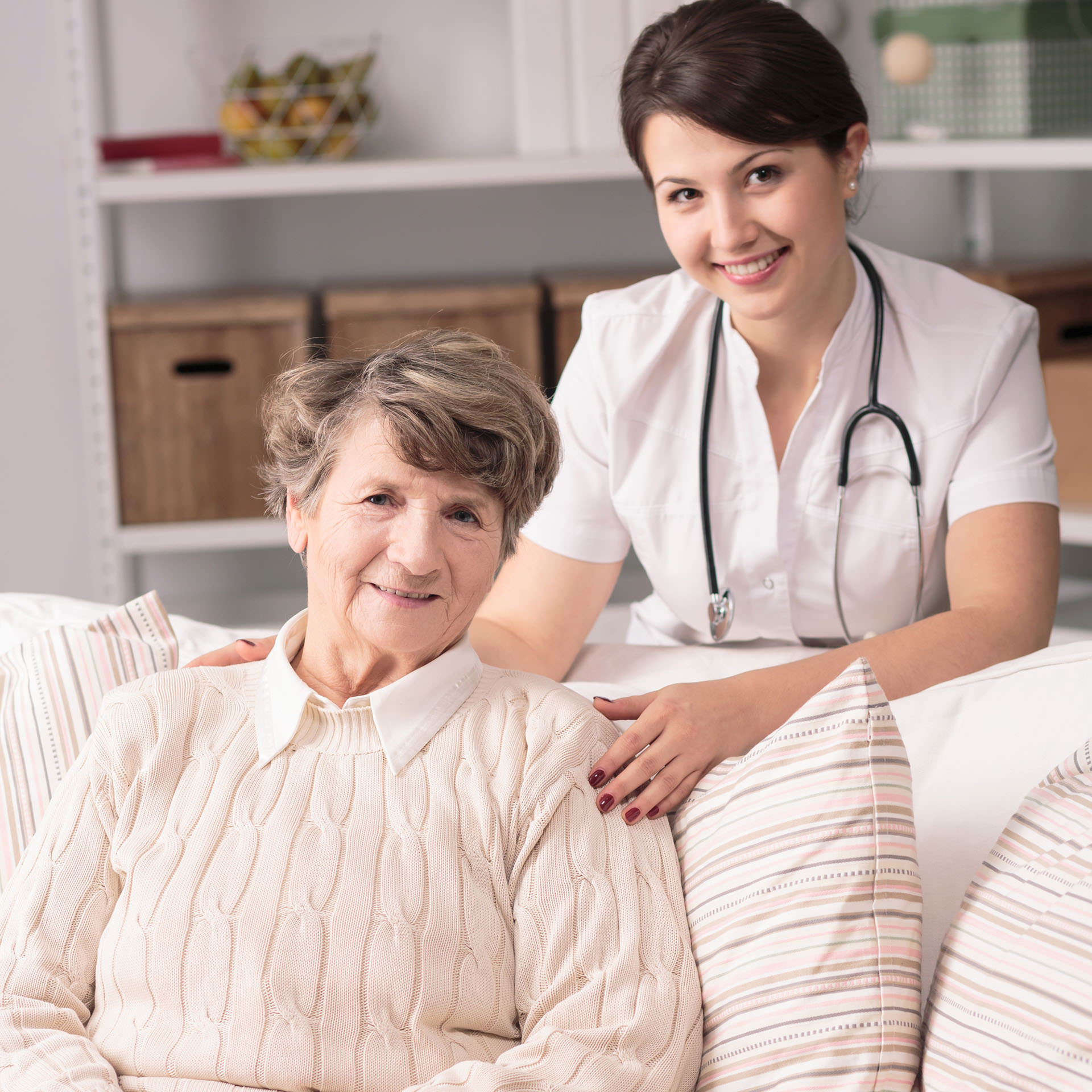 Senior patient and doctor during home visit