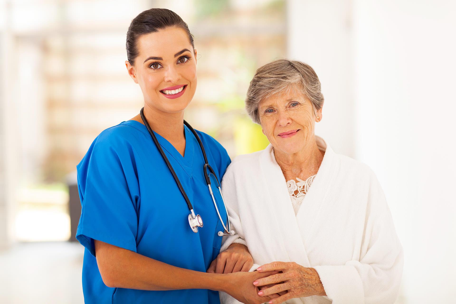 senior woman and caregiver nurse