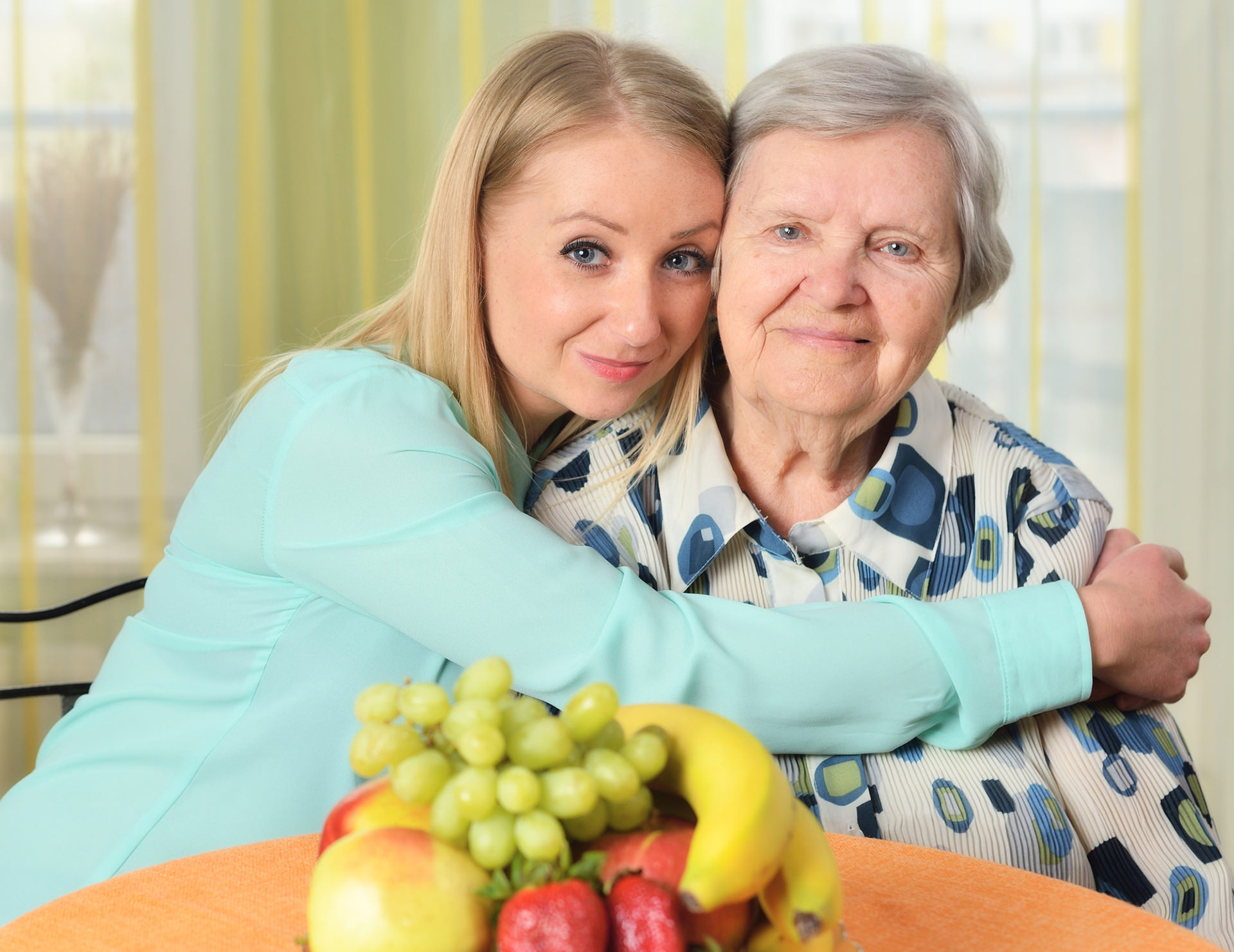Senior woman with her caregiver women