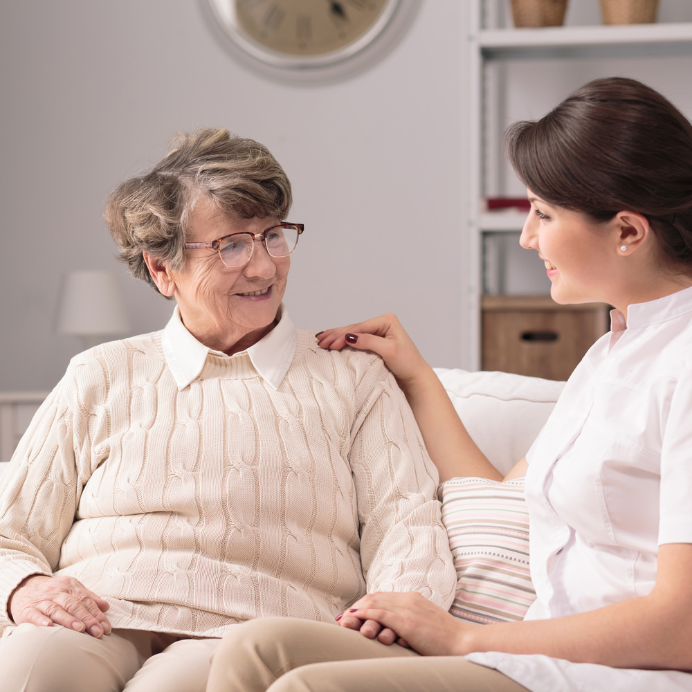 Supportive Caregiver and older lady
