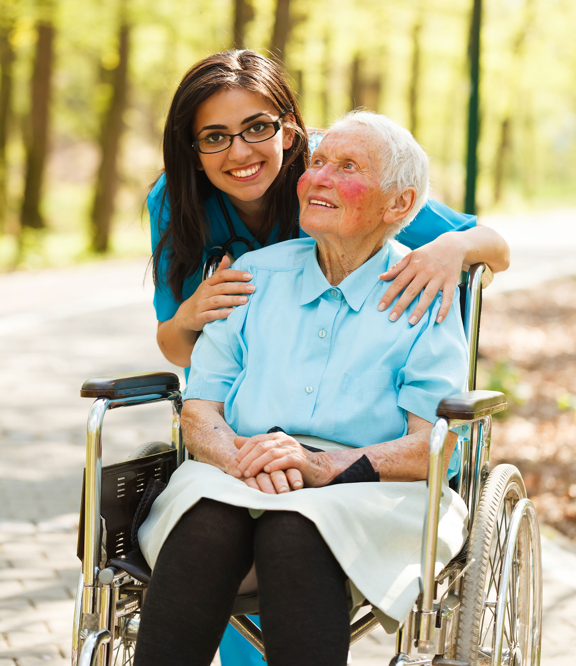 Woman in Wheelchair and Caregiver Nurse